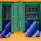 Windows with Blue Curtains
